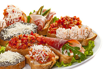 Closeup of plate of various bruschettas.