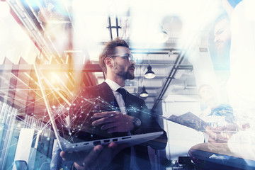 Business people work together in office with a laptop. Concept of teamwork and partnership. double exposure