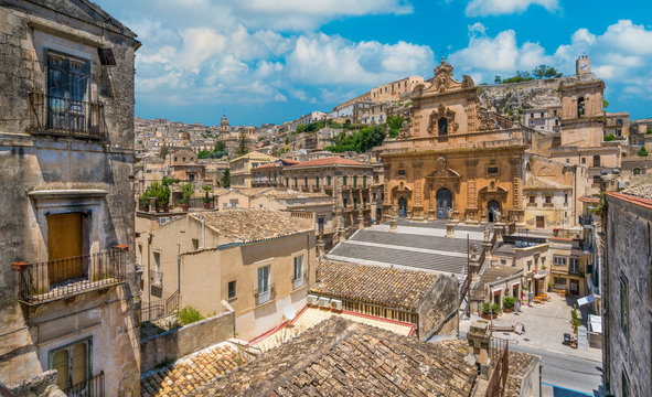 Scenic sight in Modica with the Cathedral of San Pietro and the Duomo of San Giorgio in the background. Sicily, southern Italy.