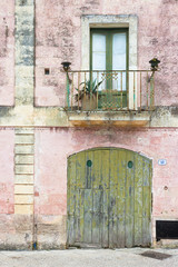 Specchia, Apulia - Beautiful old facades and balconies in the old town of Specchia