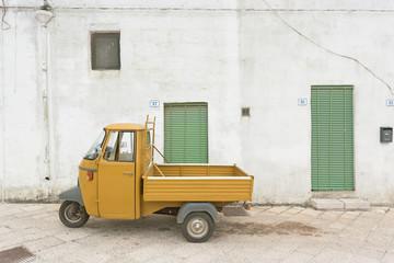 Specchia, Apulia - An old historic three wheeler in the streets of Specchia