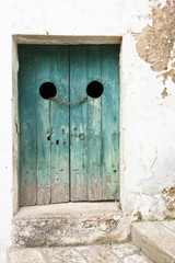 Specchia, Apulia - An old wooden door tightened with a steel track