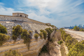 Marsaxlokk, Malta. The fortress wall and dry moat of the British Fort Delimar, 1876 - 1888