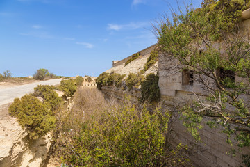 Marsaxlokk, Malta. The fortress wall and dry moat of Fort Delimara, 1876 - 1888