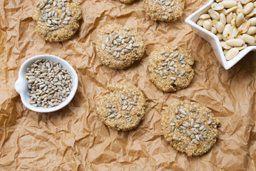 Cokies of oat and cereal with seeds and nuts. Food flat lay background.