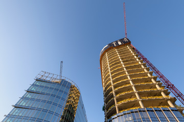 Apartment skyscrapers under construction in Warsaw, Poland