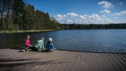three girls look at lake
