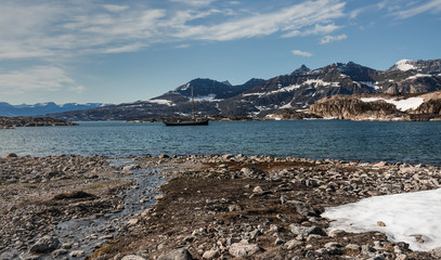 Arctic landscape with a sailing ship in Scoresby Sound, East Greenland