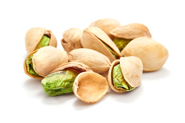 heap of ripe pistachio isolated on whtie background