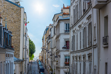 Sun shining over a narrow street in Paris