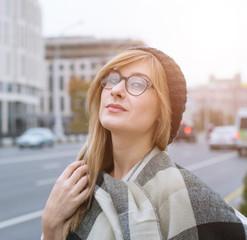 Beautiful woman in the city street