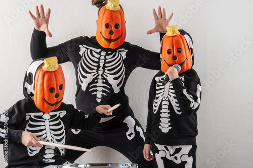 Skeleton Family Halloween Costumes.Happy Friendly Family Of Musicians In Carnival Costumes
