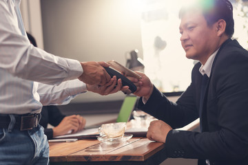 Businesses pay by scanning a QR code in a restaurant,