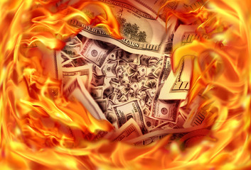 Conceptual finance image of burning pile dollar bill and fire flames