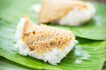 Thai dessert (Khao Niao Sangkhaya), Sweet sticky rice with egg custard on top and wrapping with fresh banana leaf
