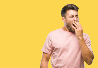 Young handsome man over isolated background bored yawning tired covering mouth with hand. Restless and sleepiness. Wall mural