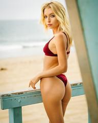 Portrait of blond girl in burgundy bikini in Venice Beach, California
