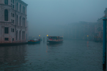 Water taxi on a foggy morning in Venice Italy