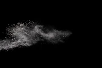 White powder isolated on black background.