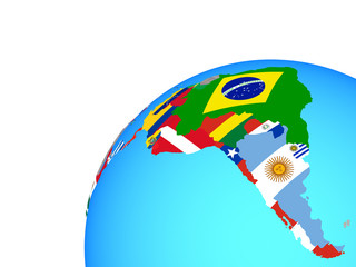 Latin America with embedded national flags on globe.