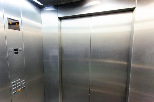interior of a modern silvery elevator