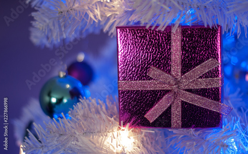 White Christmas Tree With Blue Lights.Pink Gift Box In White Christmas Tree With White Light Blue