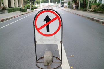 Standing traffic sign on the road, do not go straight. Sign concept.