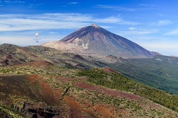 Great view of the Teide volcano with a flying paraglider. Las Cañadas del Teide. Tenerife. Canary Islands..Spain