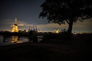 the windmills in Kinderdijk are illuminated