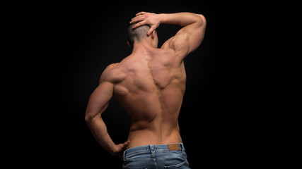 shirtless man in jeans on hips put his hand on waist.