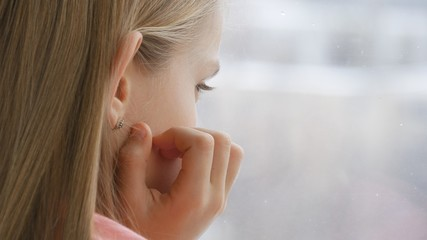 Sad Child Looking on Window, Unhappy Thoughtful Kid, Girl Face, Snowing Winter