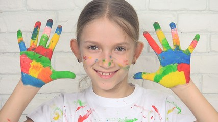 Child Playing Painted Hands Looking in Camera, Smiling School Girl Face, Kids