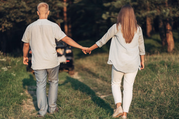 Outdoor Portrait of Young Couple in Love