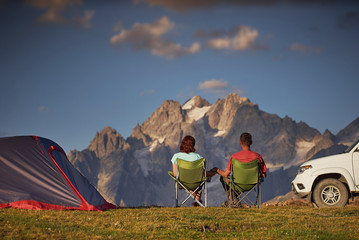 Shot of couple in a camping at mountain area.
