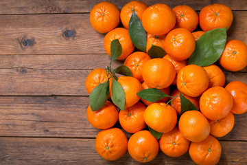 Fresh mandarin oranges fruit or tangerines with leaves, top view