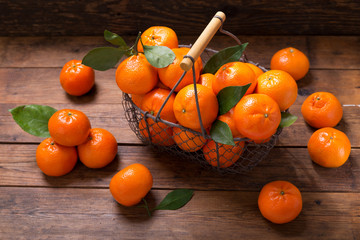 Fresh mandarin oranges fruit or tangerines with leaves in a basket