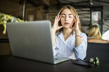 Lifestyle freelance woman working woman and laptop computer he headache unhappy on job in coffee cafe shop