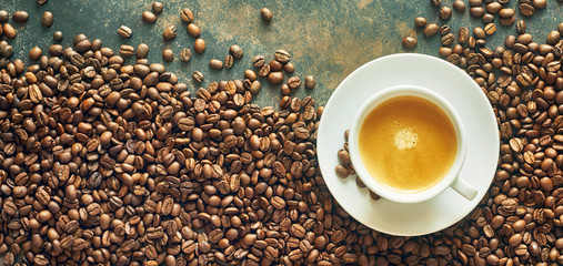 Panorama banner with cup of coffee and beans