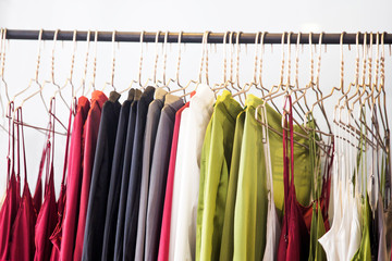 Fashionable clothes is hanging in the store