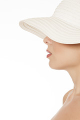 Profile of unknown woman with hat on white background
