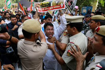 Supporters of India's main opposition Congress party scuffle with police during a protest demanding the resignation of India's Minister of State for External Affairs Mobashar Jawed Akbar in New Delhi