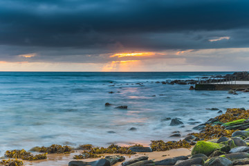 Sunrise Seascape with Threatening Storm Clouds