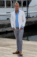 "Adventurer Ben Fogle poses during a photocall for the television series ""Survival of the Species"" during the annual MIPCOM television programme market in Cannes"