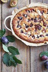 Plum cake. Spicy cake with plums, almond filling and cinnamon. Overhead view