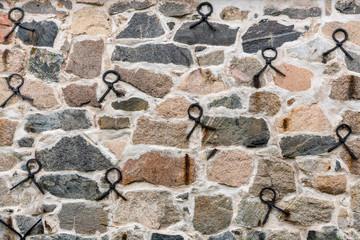 Beautifully handmade rock wall with iron loops.