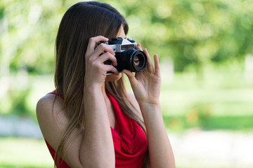 Smiling young woman using a camera