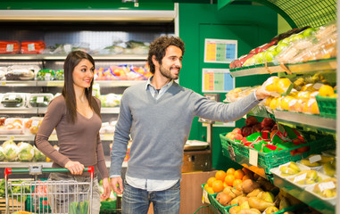 Couple choosing food in a grocery store