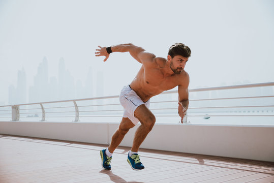 Beautiful man doing work out and different exercises outdoor