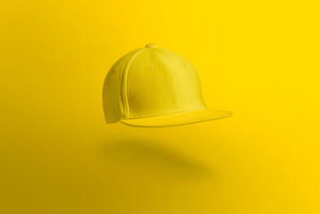 Blank cap in perspective view. Yellow snapback on yellow background. Blank baseball snap back cap for your design. Mock up hat cap for you logo, brand identity etc.
