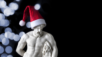 muscular male figure with a Santa Claus hat